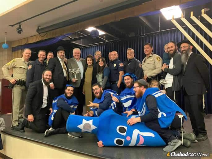 Gov. Steve Sisolak and Nevada First Lady Kathy Sisolak joined first responders to visit Chabad of Southern Nevada's Desert Torah Academy in Las Vegas, where they joined in the menorah-lighting and Chanukah festivities. (Credit: Chabad of Southern Nevada)
