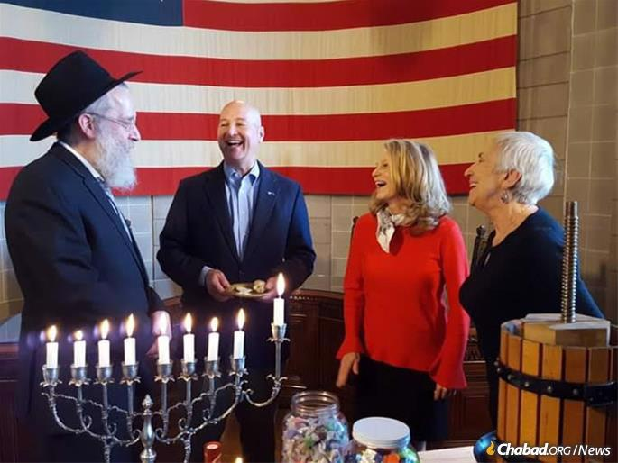 While scheduling conflicts precluded a capitol menorah-lighting this year, Gov. Pete Ricketts has joined previous Chabad menorah lightings at the State Capitol in Lincoln, including last year (pictured). Gov. Ricketts is scheduled to deliver a post-Chanukah message in January.