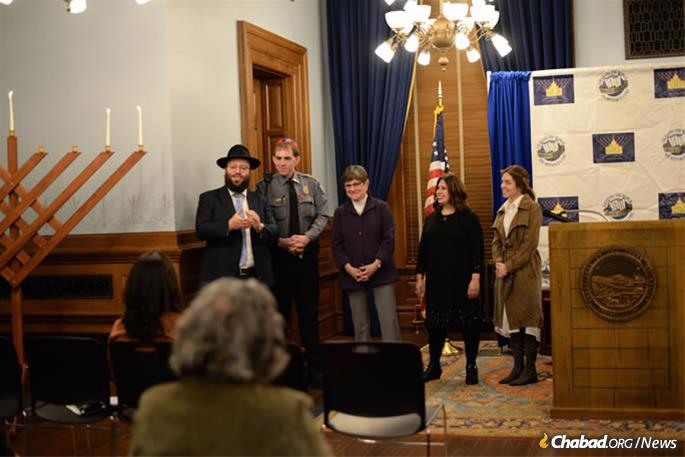 Gov. Laura Kelly (center) joined Chabad-Lubavitch Rabbi Zalman Tiechtel (left) for a menorah-lighting at the State Capitol in Topeka. (Credit: Jillian Fitzmorris)