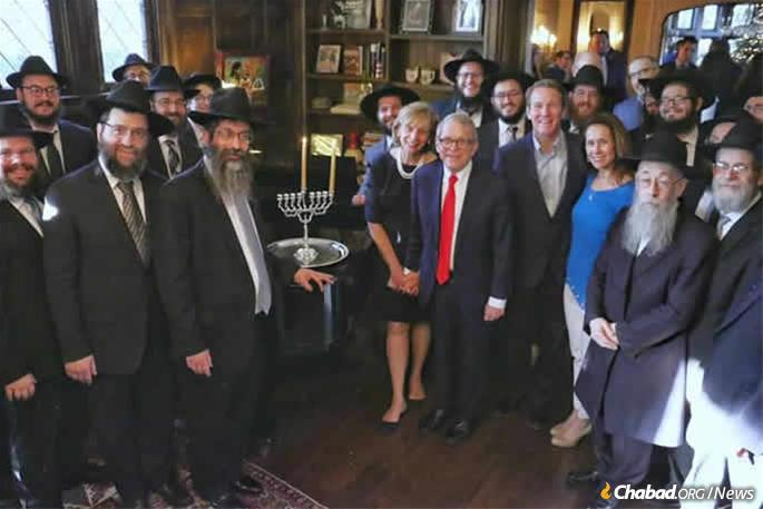 Mike DeWine and First Lady Frances DeWine hosted Chabad rabbis from around the state of Ohio for a Chanukah celebration and menorah lighting ceremony in the Governor's Mansion. In his remarks, DeWine remembered his father, Richard Lee DeWine, who helped liberate the Dachau concentration camp as a soldier in the U.S. Army during World War II. (Credit: Moshe Sasonkin)