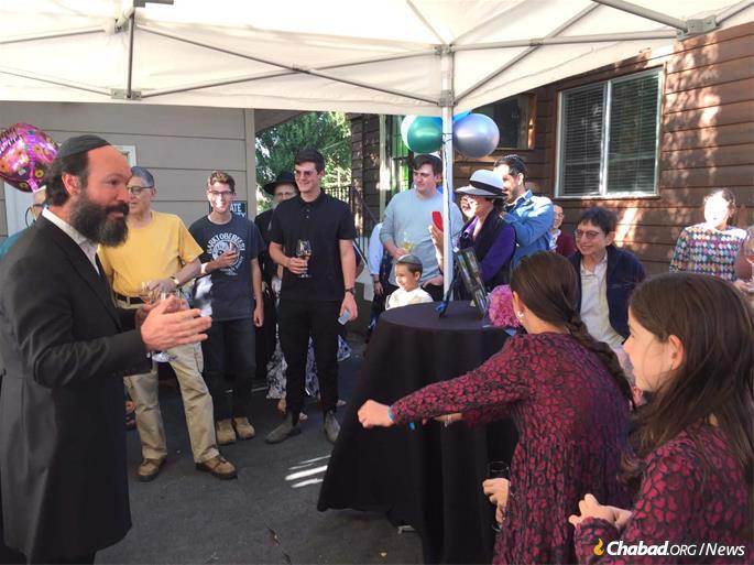 There was a lot of excitement at the bat mitzvah party and a lot for Chayale's father to share about Jewish traditions.