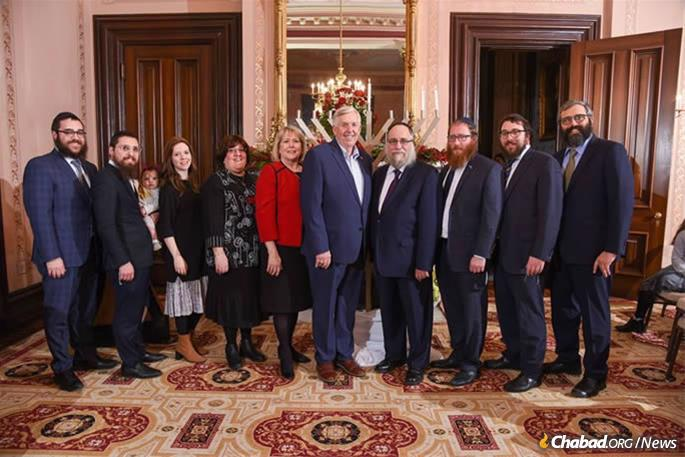 """In an annual tradition, Chabad of Greater St. Louis hosted """"Show Me Chanukah"""" at the Missouri Governor's Mansion, with Governor and First Lady Parson in attendance. (Credit: Julie Smith/Chabad of Greater St. Louis.)"""
