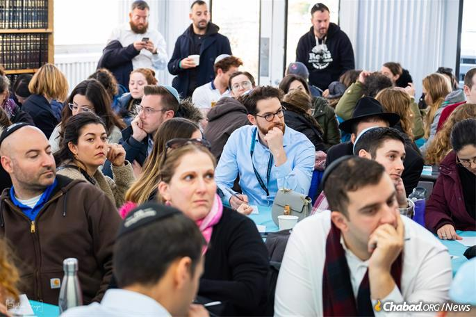 Learning more about the Rebbe at the Ohel. (Photo: Sholem Srugo)