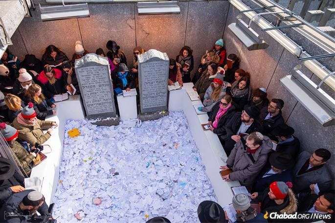 Notes, letters and requests for blessings at the Ohel. (Photo: Sholem Srugo)