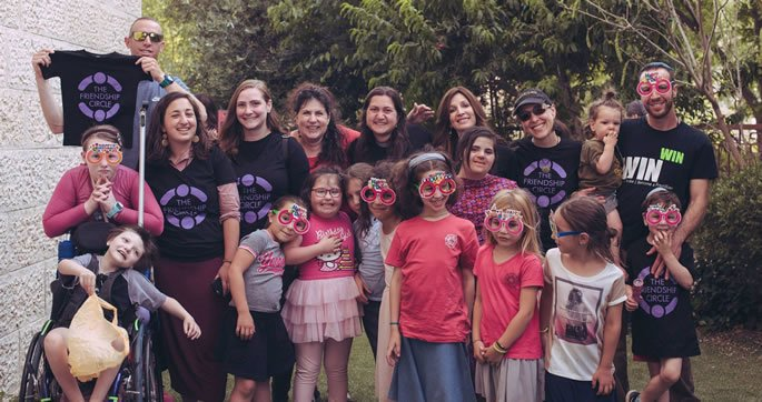 Some of the children, parents, and volunteers in the Friendship Circle of South Jerusalem gathering for a barbecue and sports clinic with Tamir Goodman.