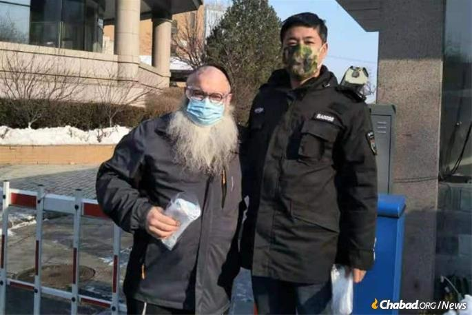 Rabbi Shimon Freundlich, co-director of Chabad Lubavitch of Beijing, gave out face masks to passersby.