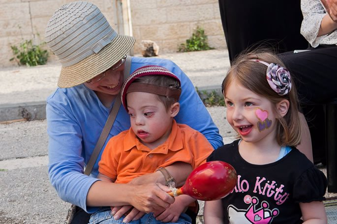 Nechama Miller with her children at a Friendship Circle event.