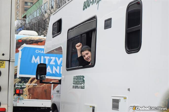 Young men offer passersby the opportunity to step inside and do a mitzvah.