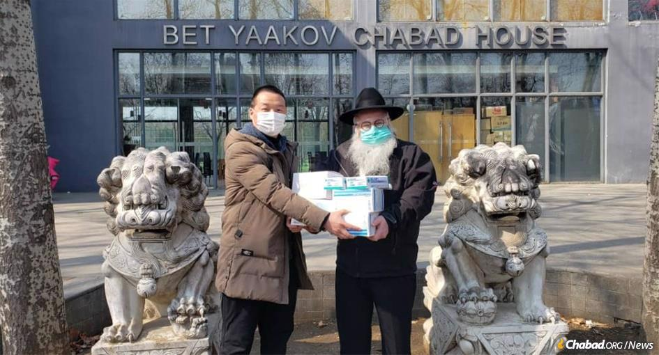 Rabbi Shimon Freundlich has stayed behind in Beijing, China, though his family evacuated to safety overseas. While much of the expatriate Jewish community has left China, Chabad-Lubavitch emissaries are still hard at work helping local residents.