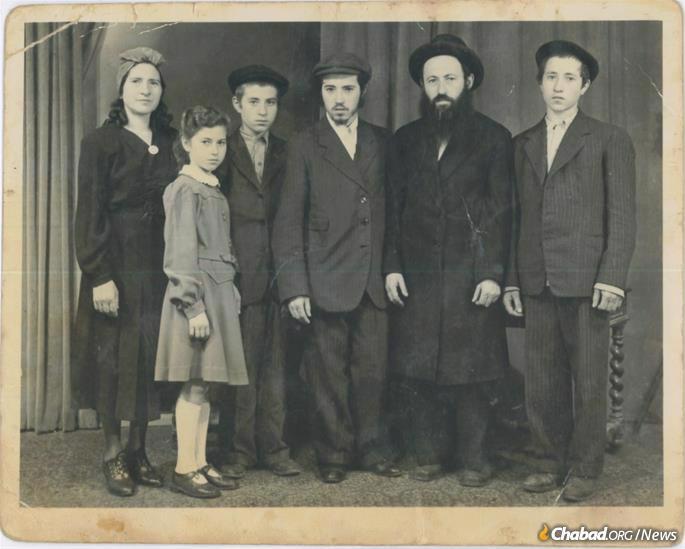 The Korf family circa late 1940s. L-R: Chaya Rivka Korf, Bas Sheva Shemtov, Rabbi Pinchas Korf, Rabbi Gedalya Korf, Rabbi Yehoshua Korf, and Rabbi Avraham Korf. Credit: Korf family.