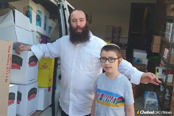 Rabbi Yochanan Gordon and son with the van and its precious cargo, which gave the rabbi ample time to distribute the goods to Tasmania's Jews in a manner that complies with social-distancing regulations.