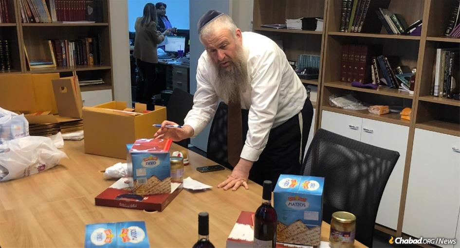 """Accustomed to hosting thousands of tourists and business travelers at Passover Mega-Seders with the assistance of 40 rabbinical students from abroad, Rabbi Yosef Chaim Kantor puts together """"Seder-to-Go"""" kits for Jewish residents of Bangkok celebrating this year at home, while reaching out to as many former guests as possible to help them host a Passover Seder."""