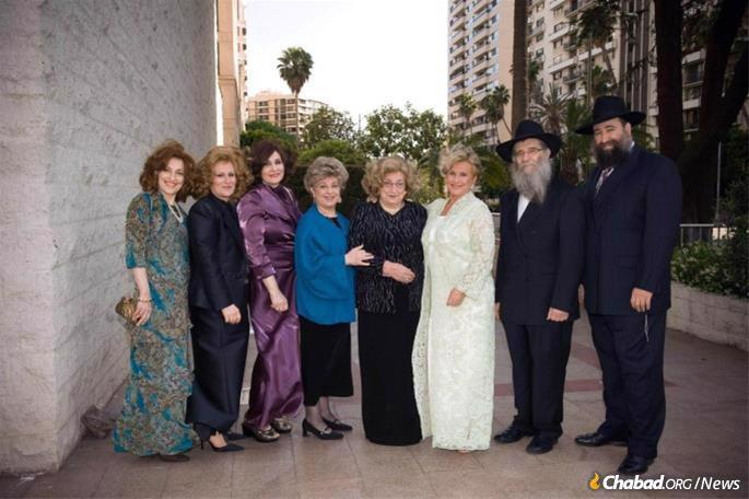 From left: Hindy Gurwitz, Shterna Krinsky, Fradel Mishulovin, Chiena Lazaroff, Guta Schapiro, Raizel Schreiber, Nachman Schapiro and Nochum Schapiro. (Photo: Lubavitch of Texas Archives)