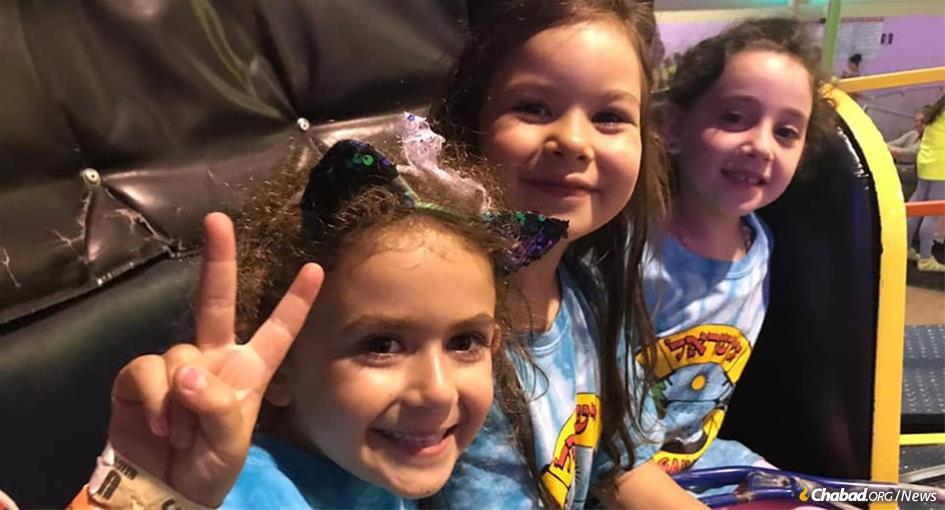Girls at Camp Gan Israel in Cherry Hill, N.J., enjoy an outing last year. Camp directors around the world are strategizing on how to balance concerns about the coronavirus with the need for summer programming. (Photo: Camp Gan Israel, Cherry Hill, N.J.)