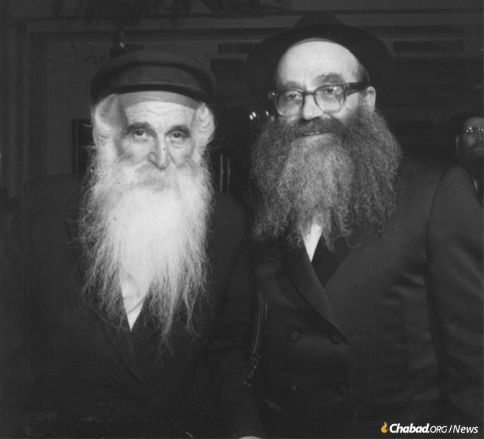 Reb Mottel, right, with his father, Reb Berke (Dovber) Chein