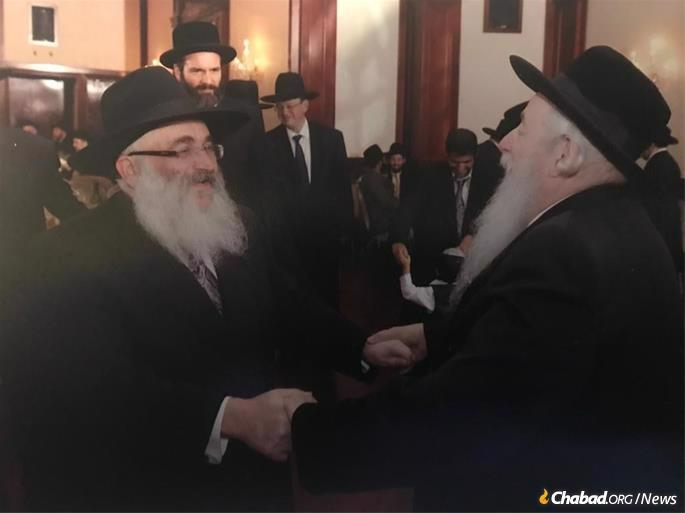 Rabbi Lipa Brennan, the Novominsker Rebbe's trusted aide for decades, dances with the Novominsker at the wedding of Rabbi Brennan's son.