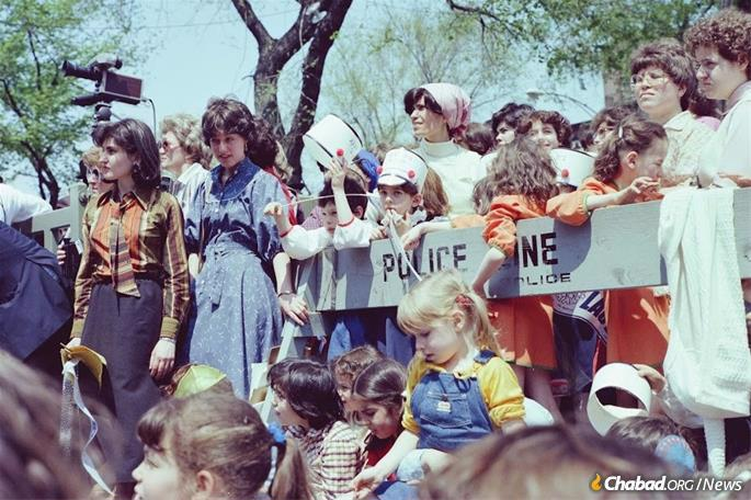 Grand Lag BaOmer parades were initiated by the Rebbe in the early 1950s, a way to engage children in a massive display of Jewish unity. Women and girls can be seen here at the 1980 parade, the largest one up to that time.