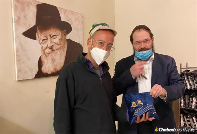 A scribe's office in Brooklyn, N.Y., opened up so the rabbi to purchase a brand-new pair of tefillin for Mendel.