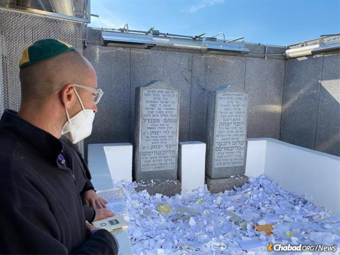 Mendel says a prayer thanking G-d for his kindness at the Rebbe's resting place, the Ohel in Queens, N.Y.