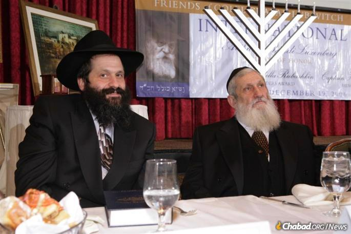 Rubashkin with his son, Sholom Mordechai Rubashkin, at a Colel Chabad dinner. The elder Rubashkin never stopped believing that his son would eventually be vindicated.