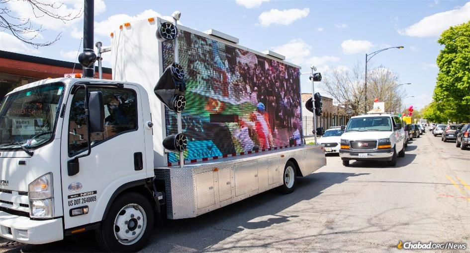 In Chicago, the Lag BaOmer parade was more than 100-vehicles strong, with an LED truck at the helm playing videos of the Rebbe and Jewish teachings. Full floats on flatbed trucks followed suit and then the family cars.