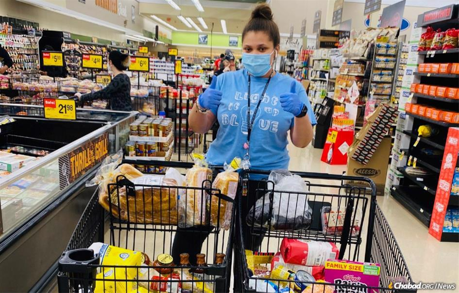Kaila Zimmerman-Moscovitch, 20, of Chicago spends hours a day at a supermarket shopping for others in the midst of the coronavirus pandemic.
