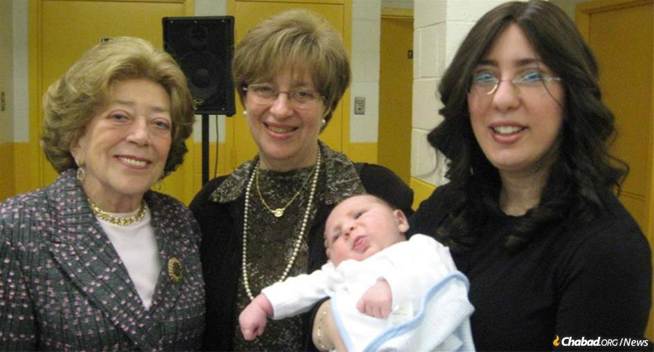 Faiga Korenblit, left, relished celebrating the growth of her family. Pictured here with granddaughter Rochel Chein, right, and her granddaughter's mother-in-law, Bracha Chein, center, at the brit milah of Korenblit's great-grandson, Menachem Mendel Chein.
