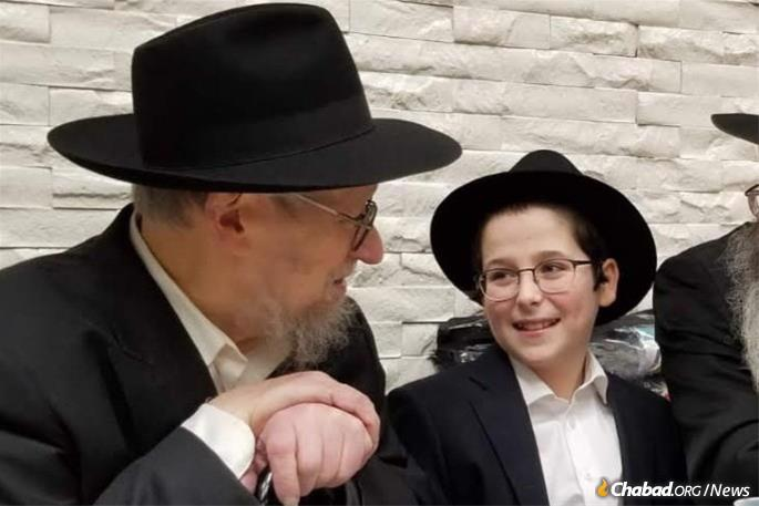 Rabbi Schwei had a close relationship with each of his grandchildren. Pictured here at the bar mitzva of grandson Moshe Yosef Ginsburg at the Chabad-Lubavitch synagogue at 770 Eastern Parkway.
