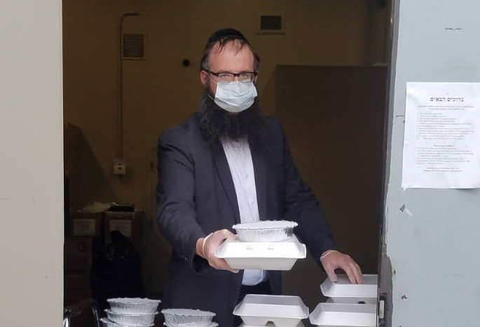 Rabbi Levi Notik of FREE (Friends of Refugees of Eastern Europe), directs the food bank.