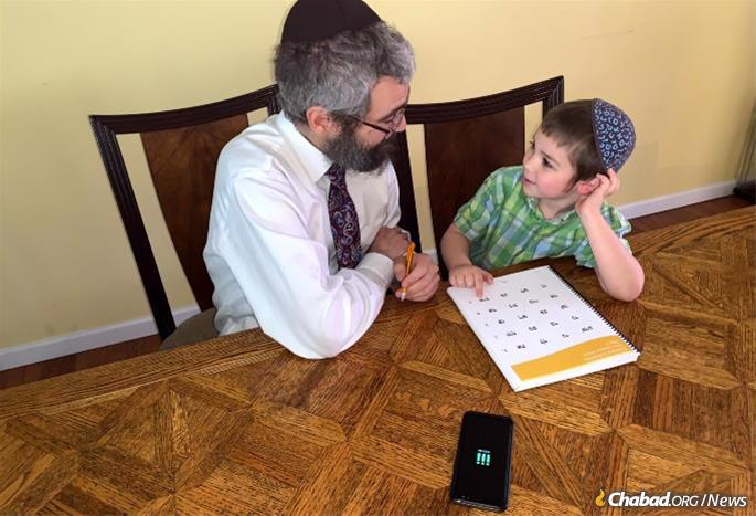 """One of the ways Rabbi Yossi Marozov uses the app is after a day at the office. """"Now when I come home from work,"""" he says, """"I hand my phone to one of my kids and say, 'Put me in the present.' They excitedly turn on PresentMode, knowing they will now have my undivided attention."""""""