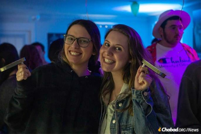 Haley Levine,left, and Jessica Ehrlich, right, a senior at the University of Delaware, sprang into action along with other students and alumnii to set up an emergency building fund.