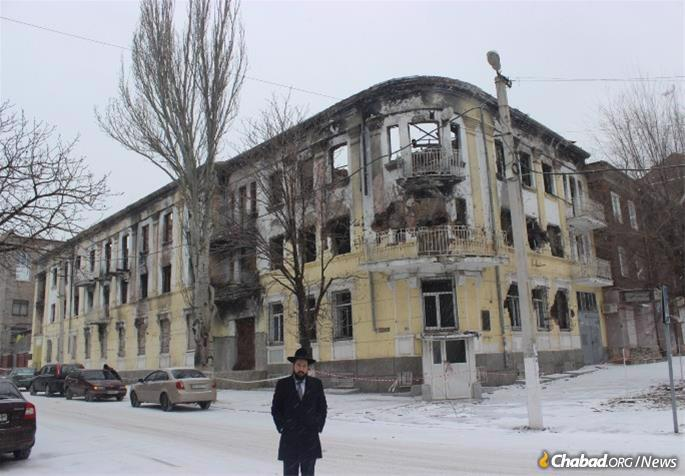 Mariupol, a strategically important industrial port city, has been a flashpoint in Ukraine's war in the east since early 2014 when heavy street fighting took a toll on the city. In this file photo, Cohen stands outside of the burned out building that served as local police headquarters.