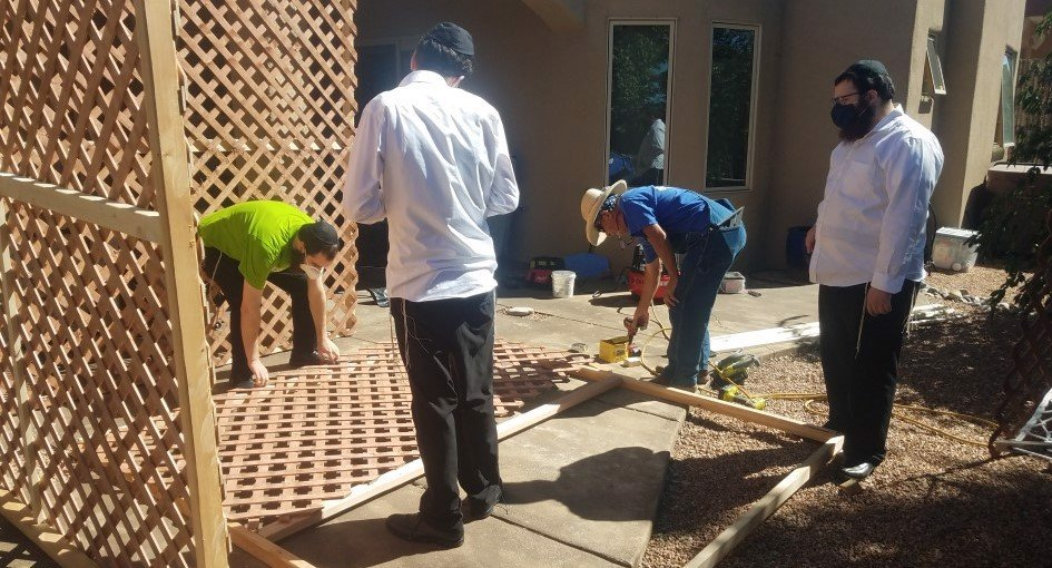Rabbi Berel Levertov, co-director of Santa Fe Jewish Center-Chabad, teamed up with his carpenter, Bob Whittet, and longtime community member Professor Stephen Hochberg to build a sukkah for Dr. Stephanie Rosen.