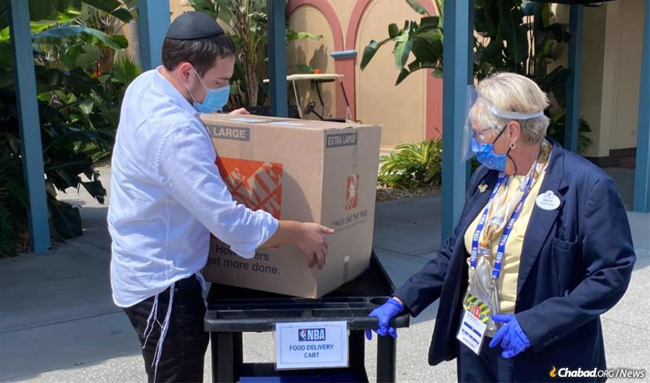 Volunteers deliver kosher food and holiday supplies for Jewish people isolated in an NBA bubble in Orlando, Fla..