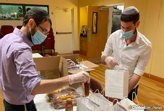 Packing honey cakes, machzors and other supplies before Rosh Hashanah. They are back at it for Sukkot.