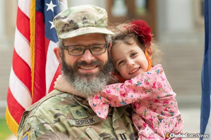 The rabbi and officer with one of his very proud children. (Photo: John Eisele/CSU)