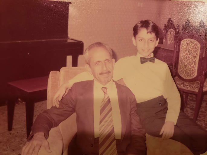 Behdad Moshe with his father in Iran.