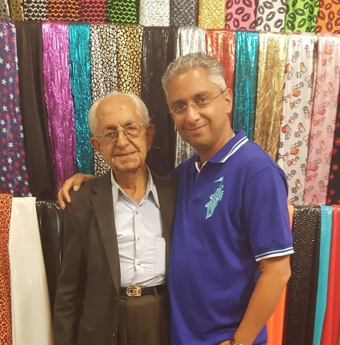 Behdad Moshe with his father, at their textile business in LA.