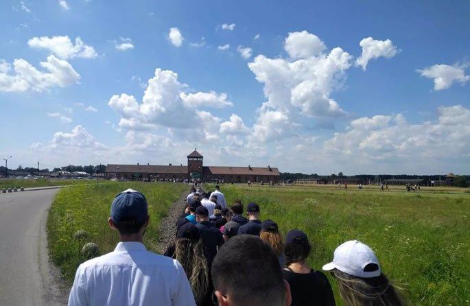 Walking down the railroad tracks to Auschwitz-Birkenau.
