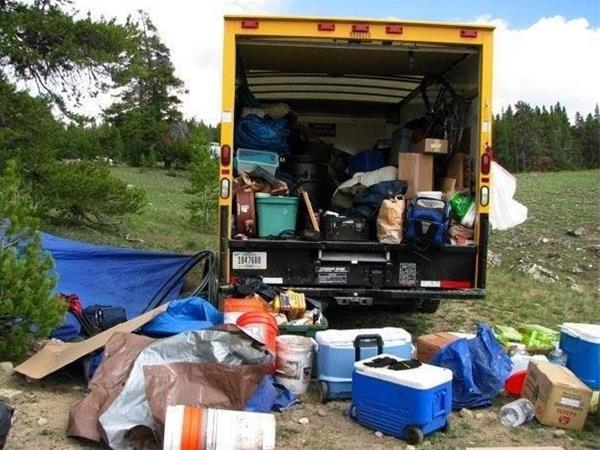 "Unpacking the ""Jerusalem Camp"" truck, 2008. ©Zev Padway"