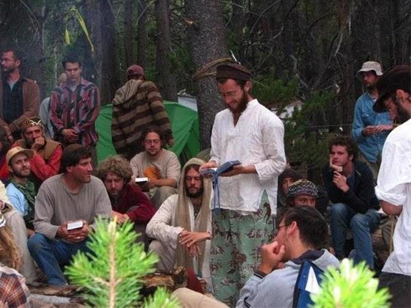 Daniel Feld (center) leads a Jewish prayer service at the Rainbow Gathering. ©Zev Padway