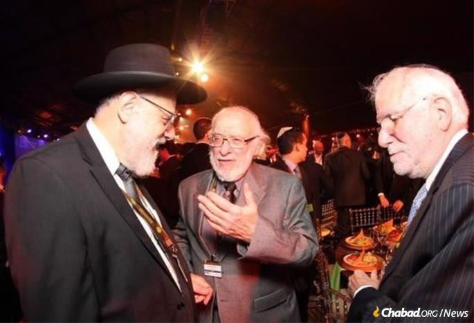 Lewin, center, at a previous International Conference of Chabad-Lubavitch Emissaries