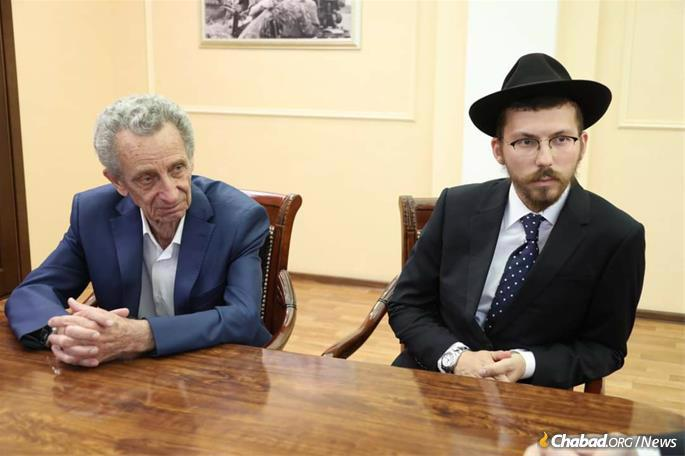 """Rachmiel Leder (left) was born in Birobidzhan and is president of the Birobidzhan Jewish community. He describes Hanukkah in the region as """"a big, beautiful holiday here. It's frosty outside, we have doughnuts, some l'chaim, Jewish songs."""" Next to him is Rabbi Efraim Kolpak, the incoming chief rabbi and Chabad emissary to the region. (Credit: Chabad of Birobidzhan)"""