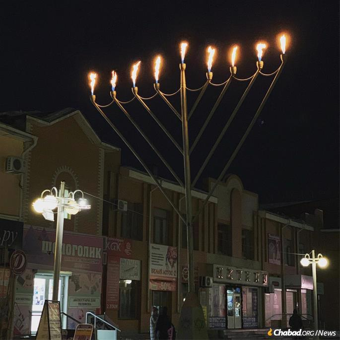 The giant menorah in Birobidzhan, capital of Russia's Jewish Autonomous Region in the Far East, stands proudly not far from the city's monument to the Yiddish poet Sholom Aleichem. Communists offered the Jews frozen Birobidzhan as an alternative homeland beginning in 1928. (Credit: Chabad of Birobidzhan)