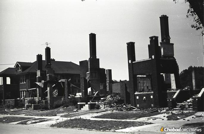 """The riots of the 1960s devastated whole neighborhoods, like this part of Detroit during the """"long, hot summer"""" of 1967. (Credit: Phil Cherner via Wikimedia Commons)"""