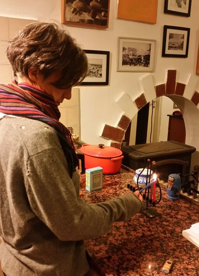 Lighting Chanukah candles at home.