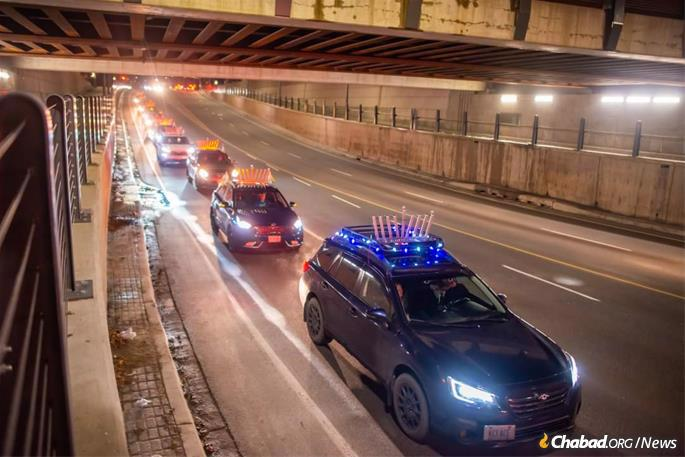 In Waterloo, Canada, nearly 30 vehicles joined together for the city's first-ever car-top menorah parade.