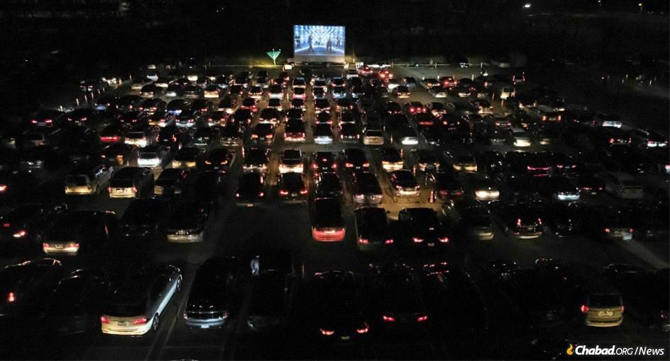 In St. Louis Park, Minn., more than 1,000-strong got into their cars for a drive-in menorah-lighting honoring health-care workers that also featured musical entertainment, inspirational videos and a light show.