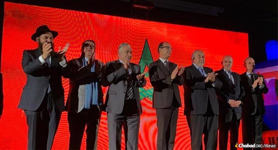 Moroccan government officials joined the Jewish community's Hanukhah festivities for 2019. From left: Rabbi Levi Banon, director of Jeunesse Chabad of Morocco; Armand Azeroual, president of Chabad institutions in Morocco; Gabriel Ruimy, president of David Hamelech Synagogue of Casablanca; Said Ahmidouch, wali of Casablanca-Settat region; Serge Berdugo, ambassador-at-large and president of the Council of Jewish Communities; Rachid Afirat, the governor of Casablanca-Anfa prefecture; and Pierre Sibony, president of the SOC.