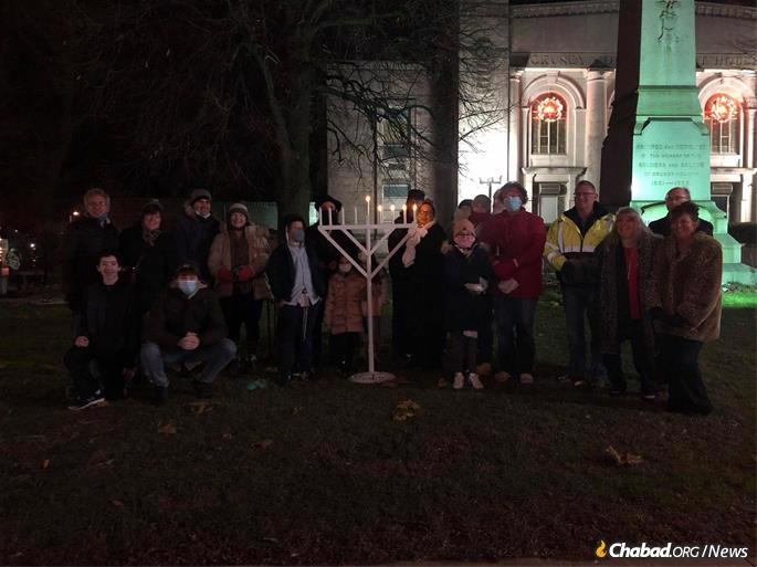 Hardy Illinoisans brave the wind and snow outside the Grundy County Courthouse in rural Morris, Ill., for a menorah-lighting and brief celebration. This year, 27 people showed up, nearly triple the amount expected.